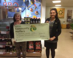 wide Our chairman receiving a donation from Waitrose in Weybridge
